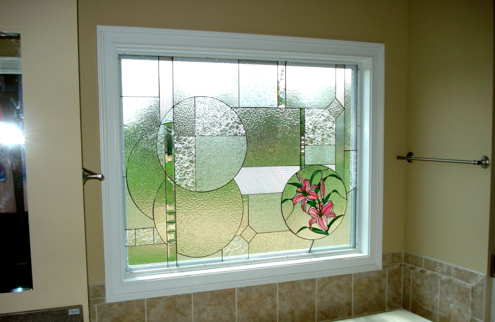 Geometric window insert installed into a vinyl frame for Bathroom window glass options