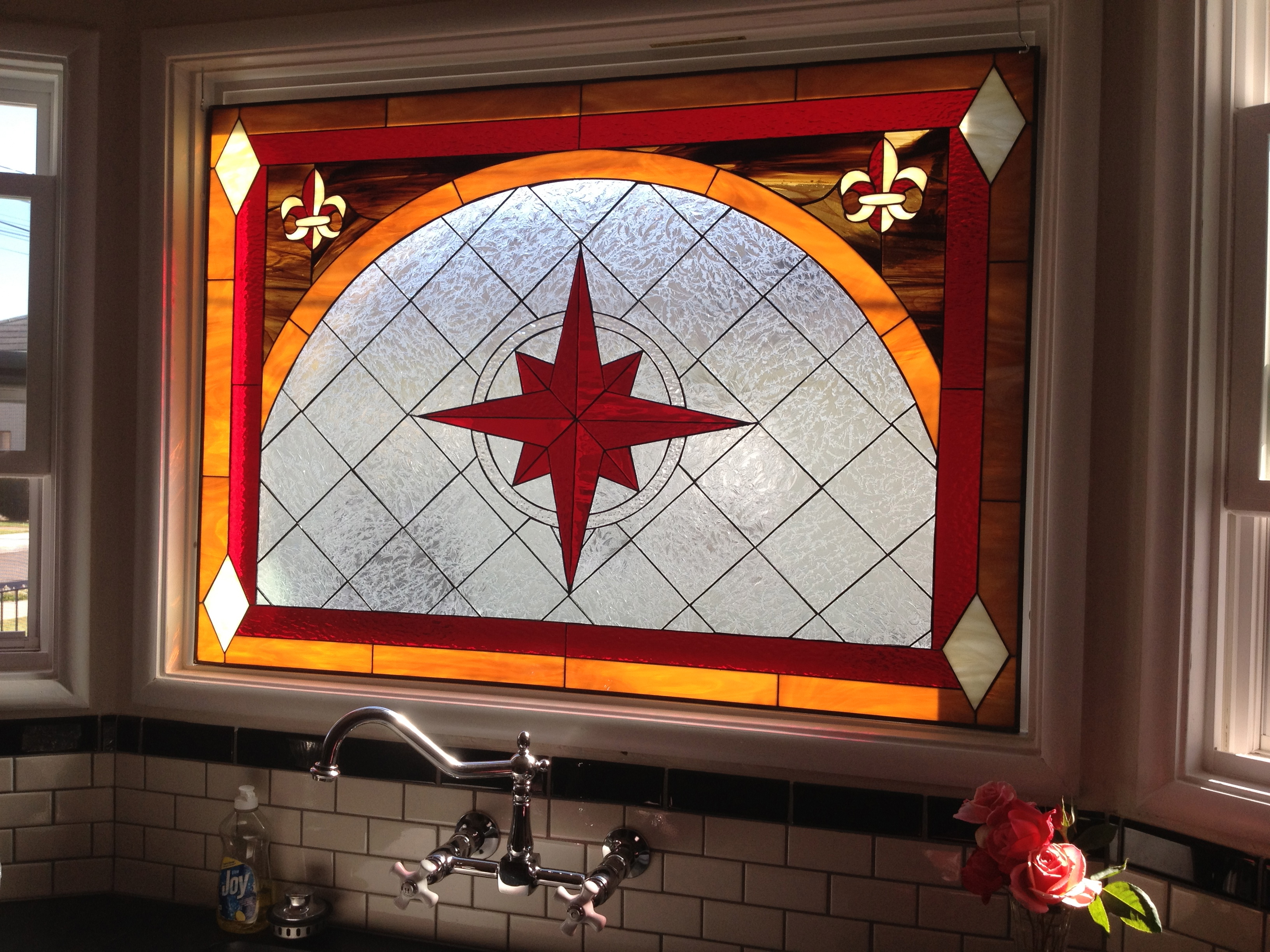 Stained glass window installed over kitchen sink for Stained glass kitchen windows