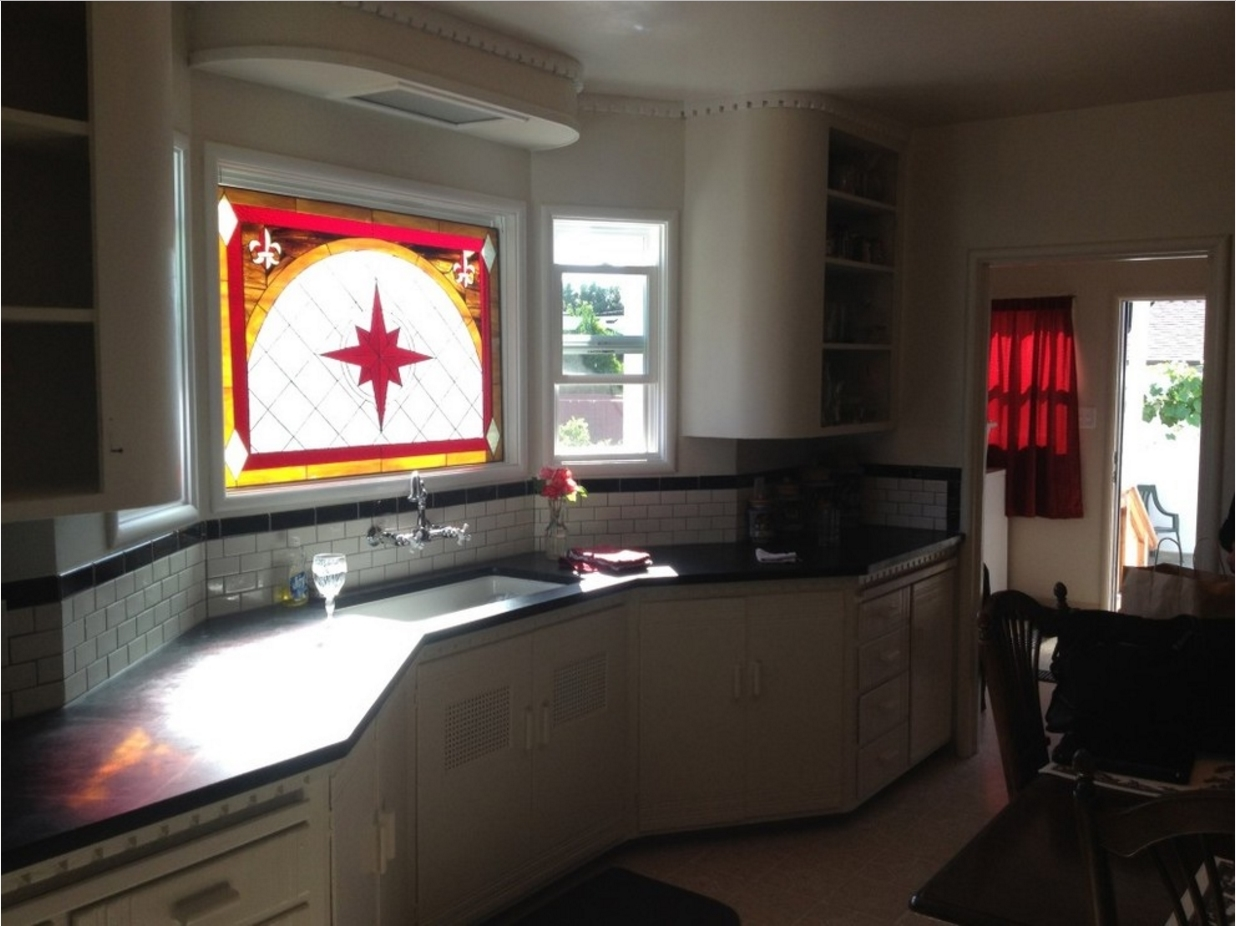 Stained Glass Window Installed Over Kitchen Sink