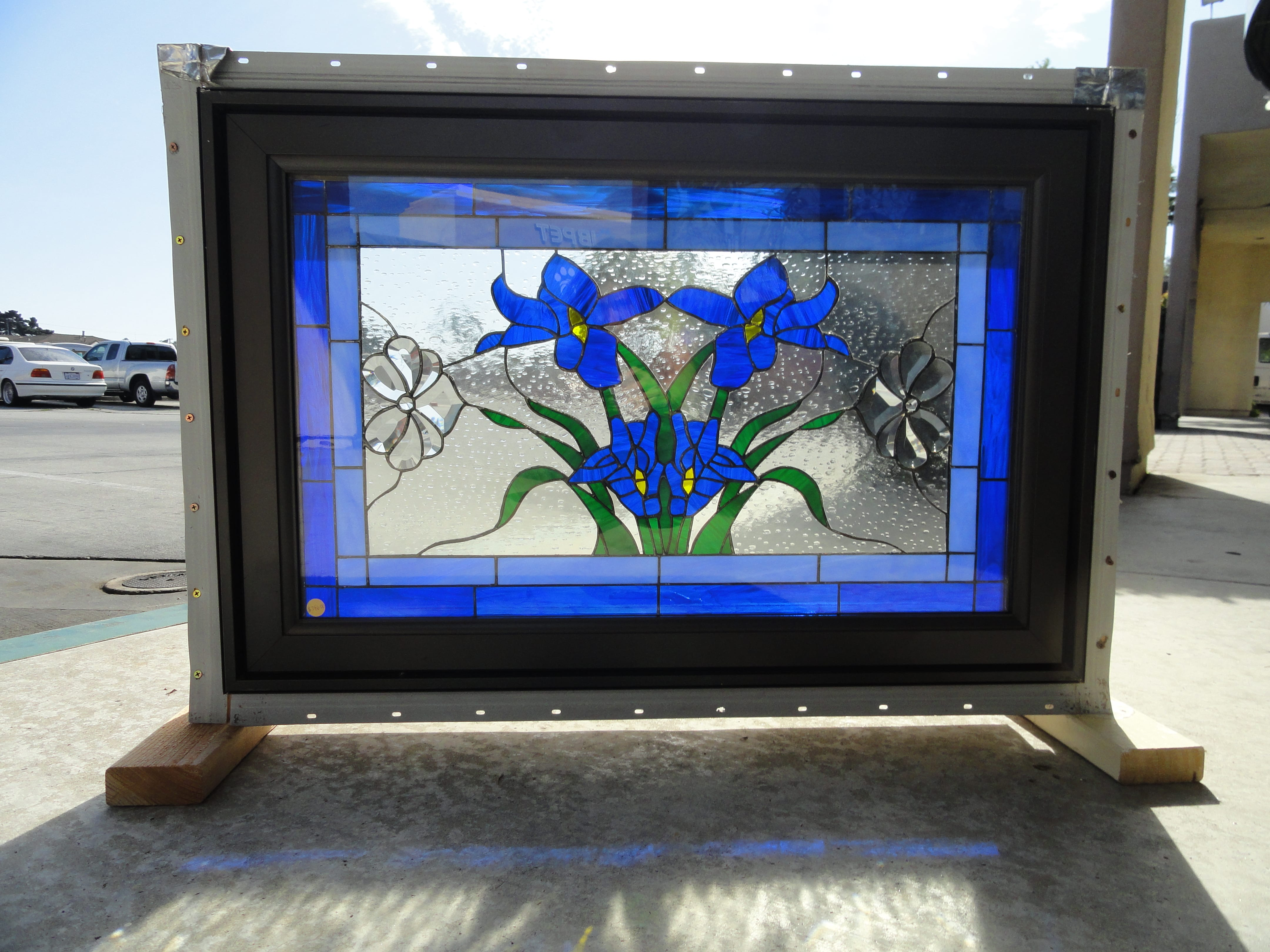 Lovely Iris Stained Glass Window Installed In A Crank Out