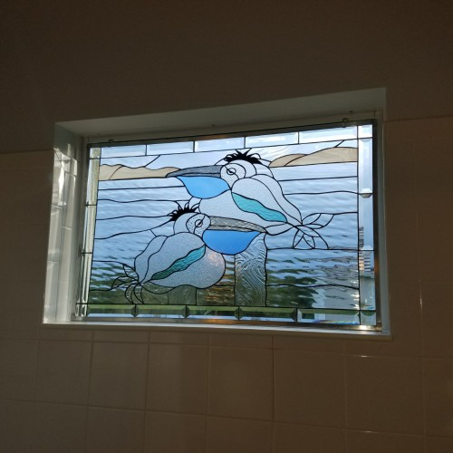 Lazy Pelicans Single Pane Window Set Against Existing Glass In Shower Area