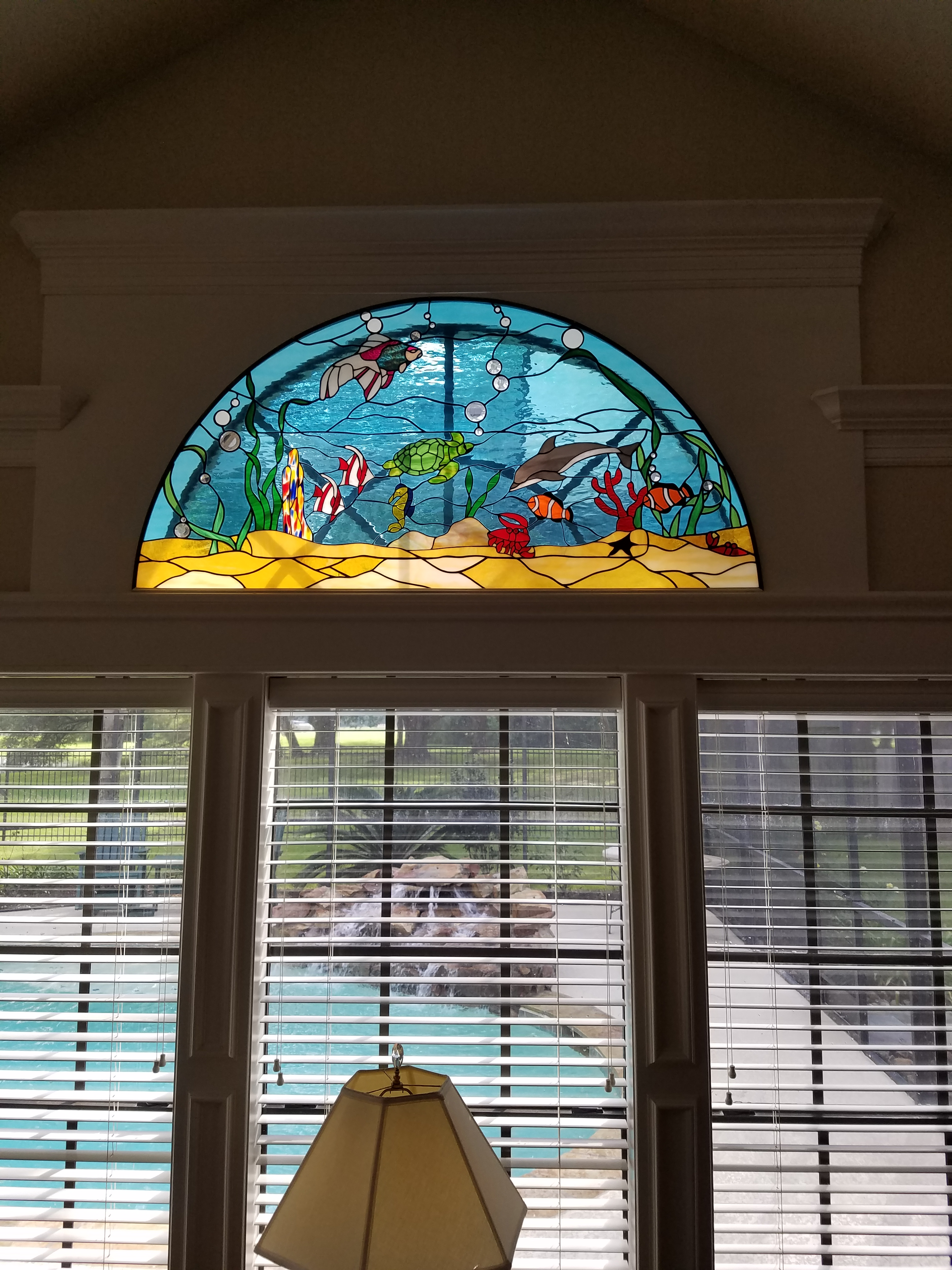 multiple ocean themed stained glass windows
