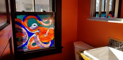 Wow!  Colorful Octopus Stained Glass Window Installed In A Bathroom