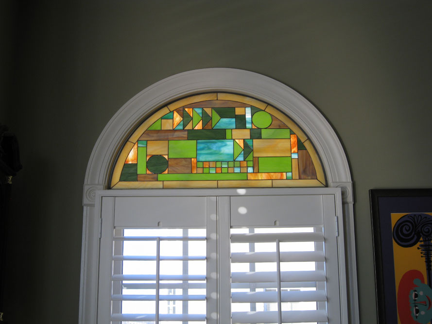 Frank Lloyd Wright style arched stained glass window