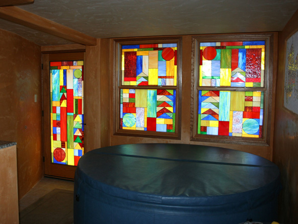 Colorful Mission/Prairie stained glass windows installed in jacuzzi room in Maui