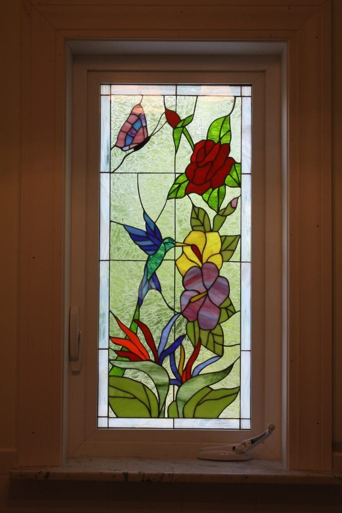 Triple paned Hummingbird & Flowers Stained Glass Window In A Crank Out Vinyl Frame