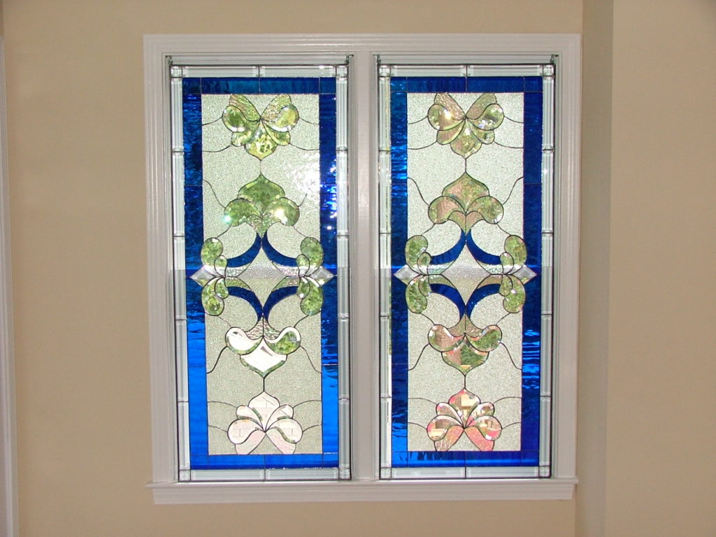 Pair Of Beveled Window Simply Hung With Hooks In Window