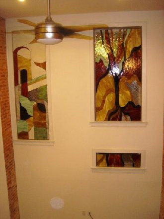 Large stained glass windows installed over a stairway