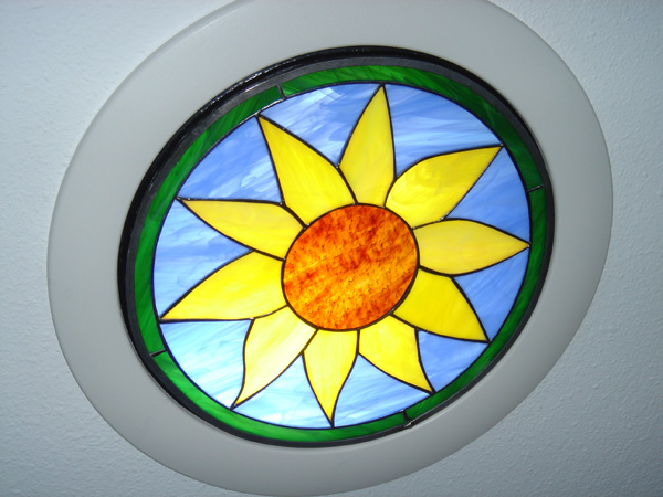 Stained glass insert installed into a skytube or skylight