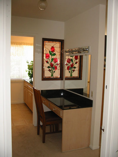 Stained Glass Rose Panel Used As A Room Divider In A Pony Wall