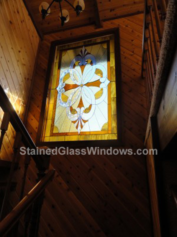 Awesome beveled & stained stairway window