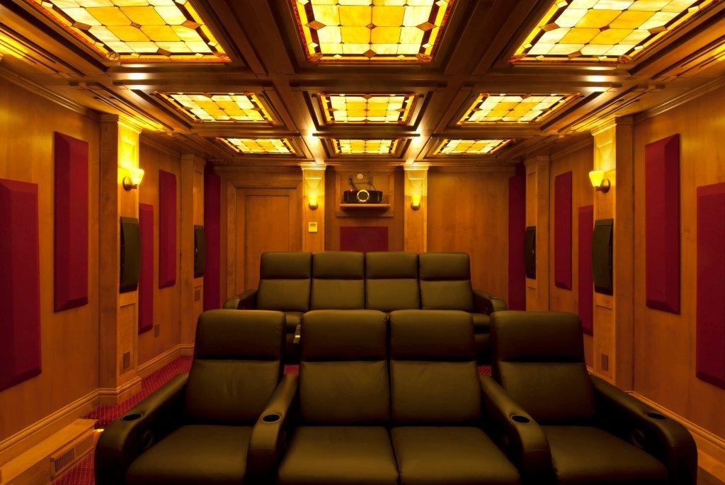 Illuminated Stained Glass Ceiling Inserts In A Home Theatre Room