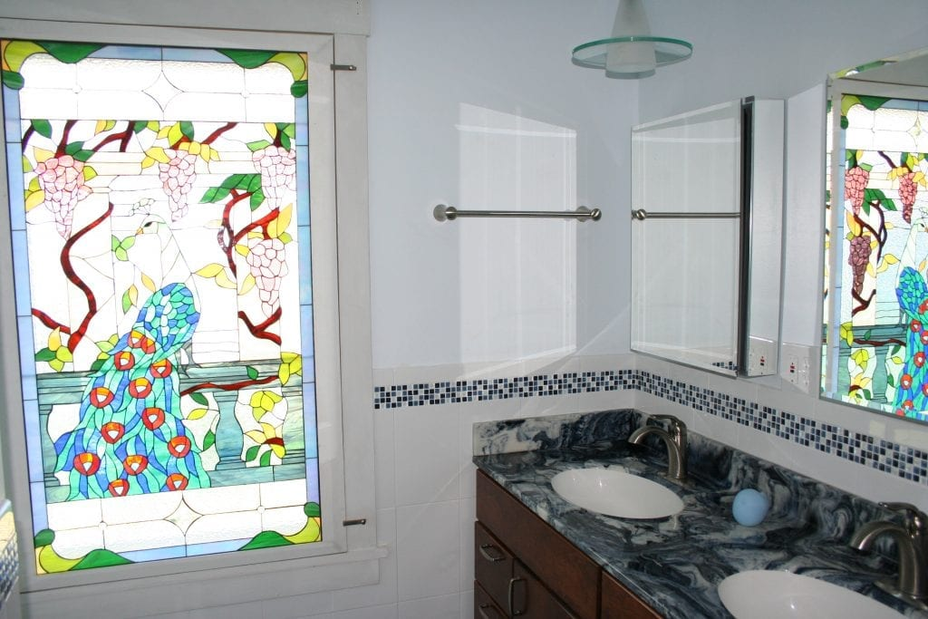 Colorful Peacock Stained Glass Window Installed Into A Bathroom