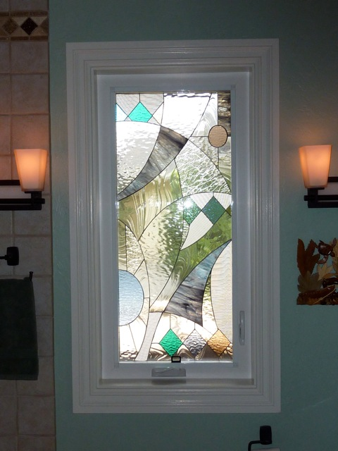 Abstract Geometric Window Installed Into A Vinyl Crank Out Frame