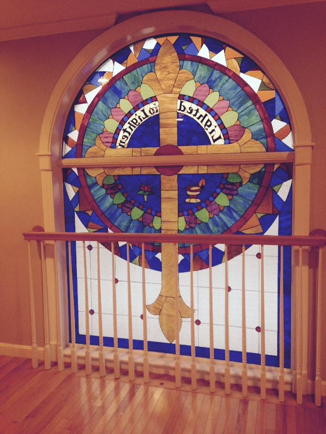 Cross Stained Glass Window Installed Into A Church