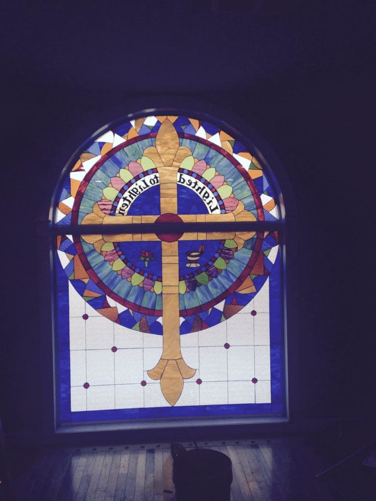 Huge Two-Piece Stained Glass Window Installed Into A Church