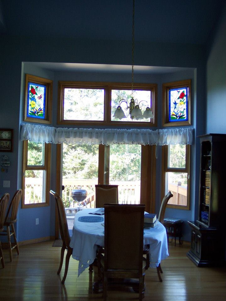 Colorful Hummingbird, Butterfly & Flowers Window Panels Accenting A Breakfast