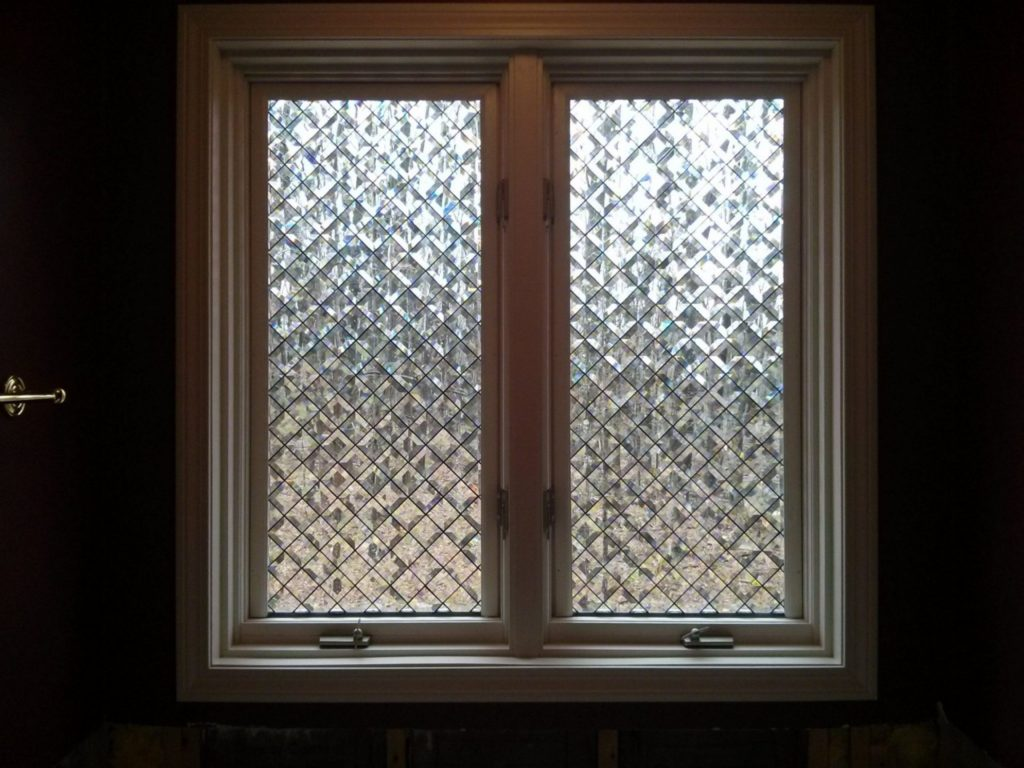 Beveled and clear textured glass tulip leaded window