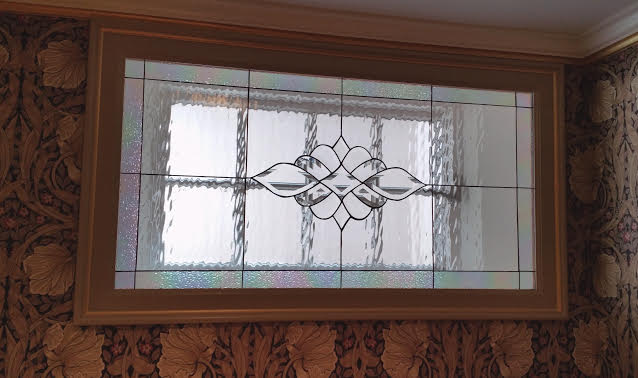 Incredibly elegant! All clear waterglass and beveled glass window panel