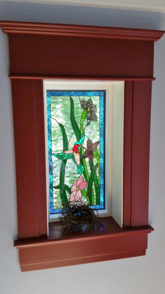 Stained glass window insulated and installed