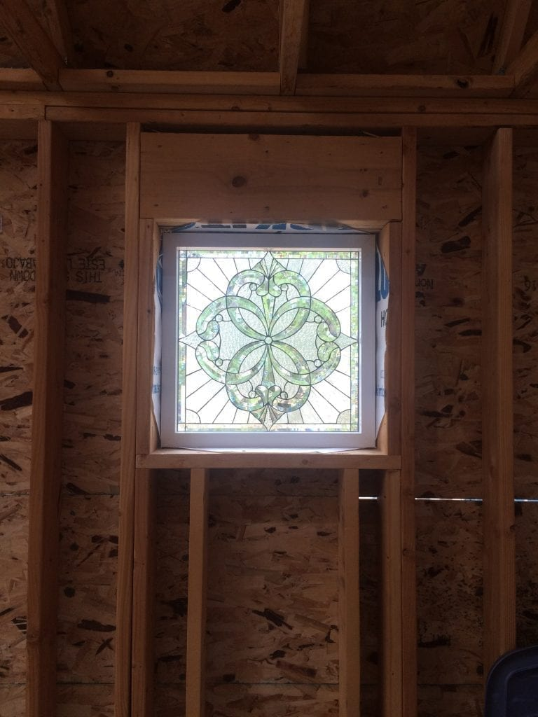 One of our beveled windows just being installed during the beginning construction phase!