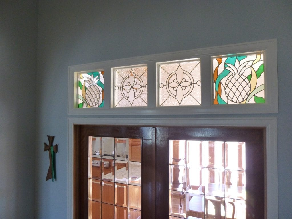 decorative pineapple & beveled transom stained glass windows