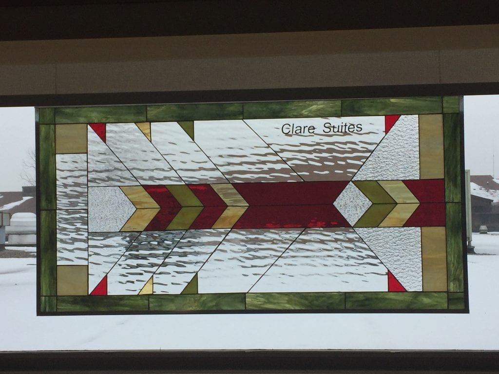 Stained glass windows hung in a Church with personalized text