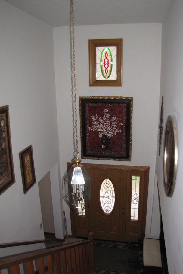 Curb appeal! Lovely stained glass window installed above an entry way!
