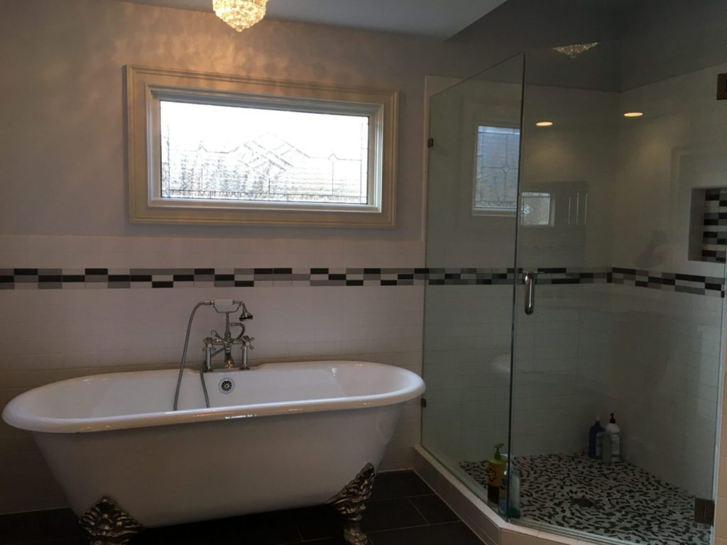Stained & Beveled Glass Insulated Window Installed Above A Bathtub