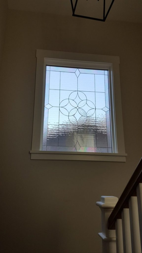 A Large Beveled All Clear Window Installed On A Staircase Landing