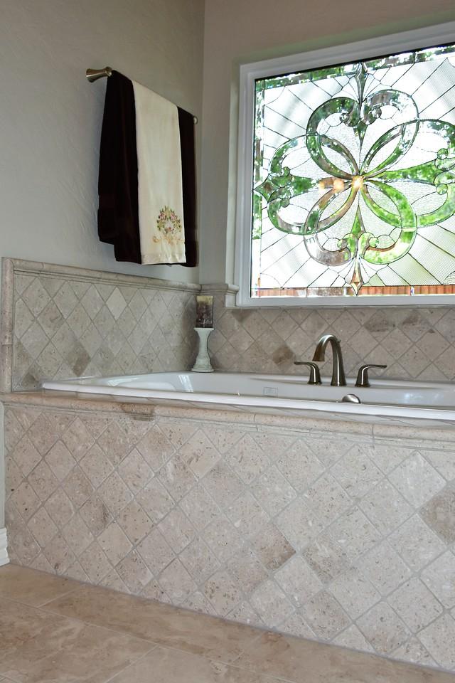 Beveled Glass Window Installed Over A Bathtub