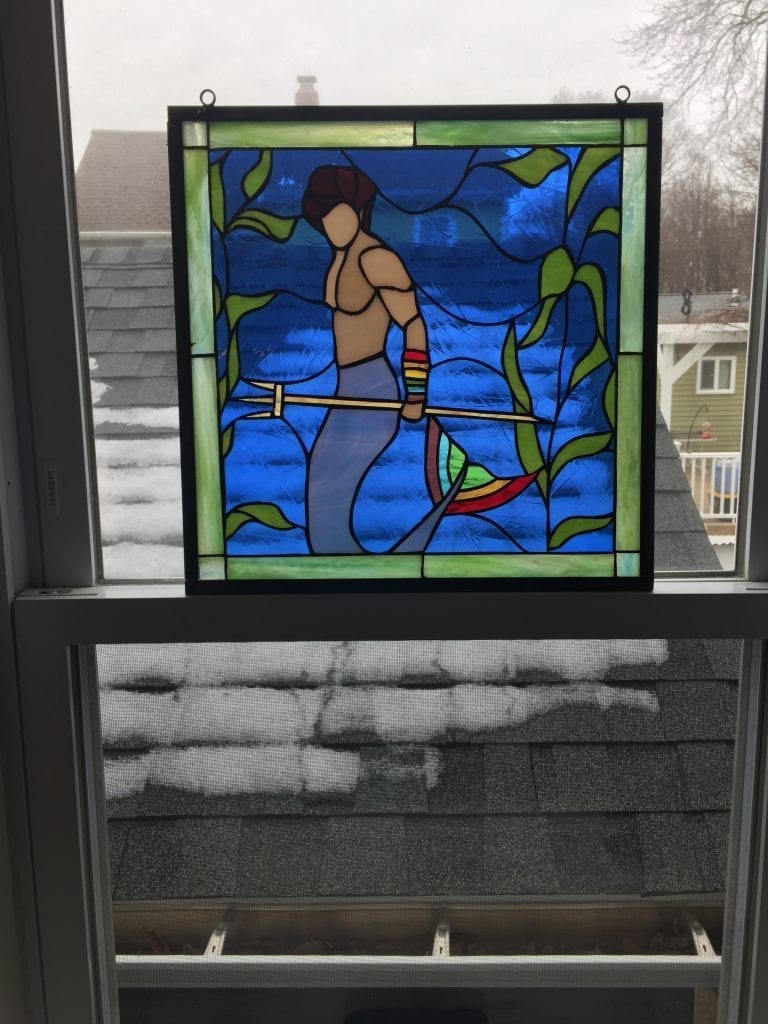 Merman Stained Glass Panel Suspended in a Window With Chains