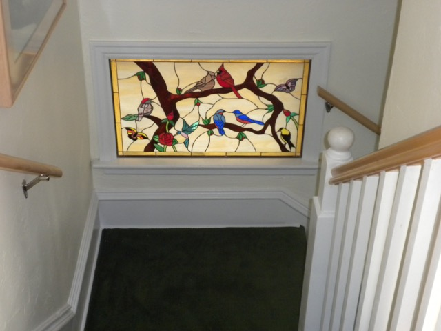 Beautiful birds and butterflies stained glass window insert for a stairway landing