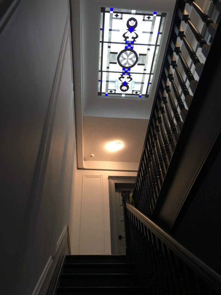 Large skylight insulated in clear tempered glass above a stairway