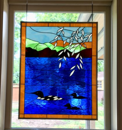 """""""Loons On The Paddle"""" Stained Glass Window Hung In A Kitchen Area"""