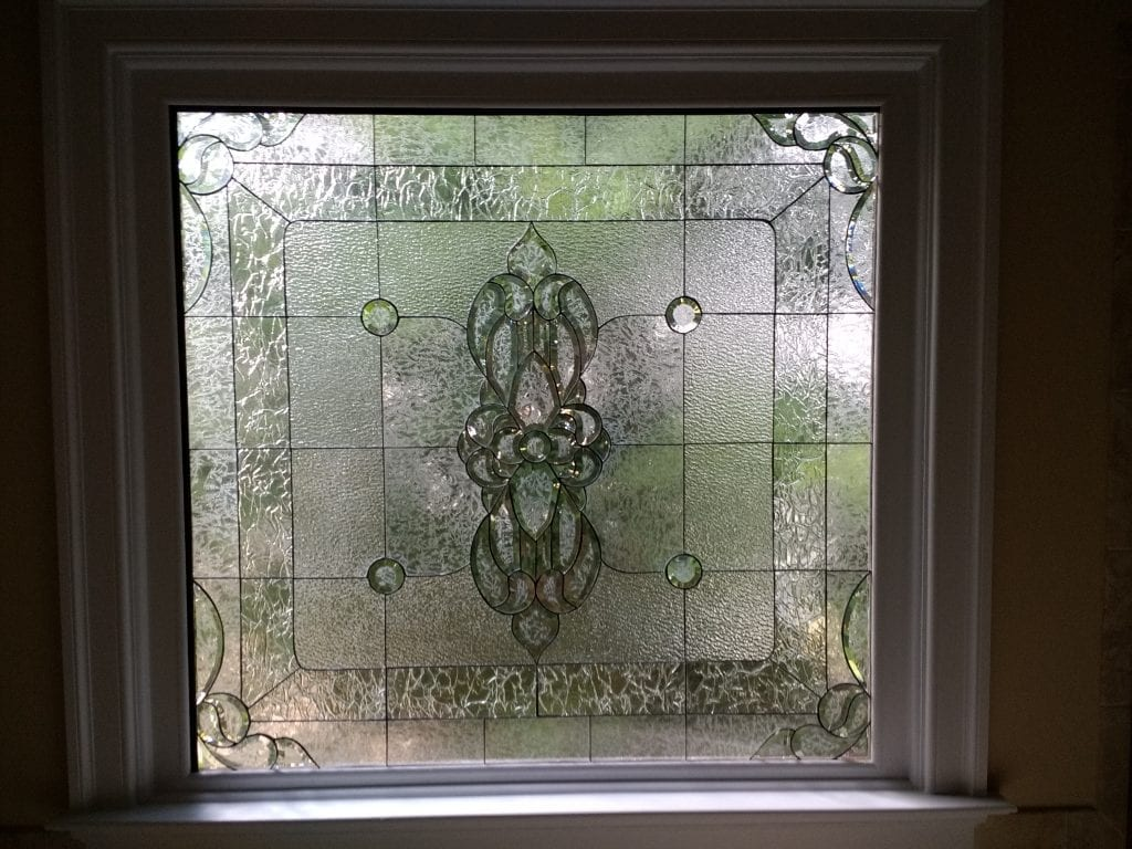 Magnificent beveled and clear textured glass window
