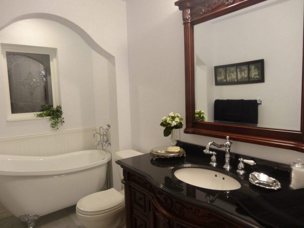A beveled leaded artglass window installed over bathtub