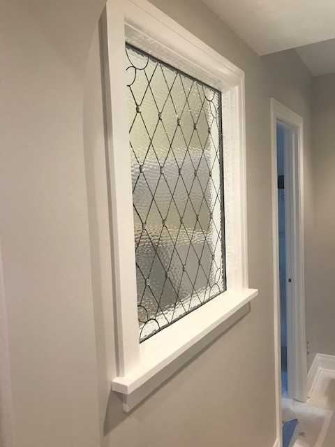 leaded glass panel used as a partition between two rooms