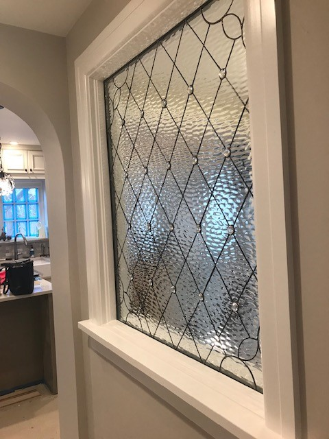 All diamond leaded glass panel used as a partition between two rooms