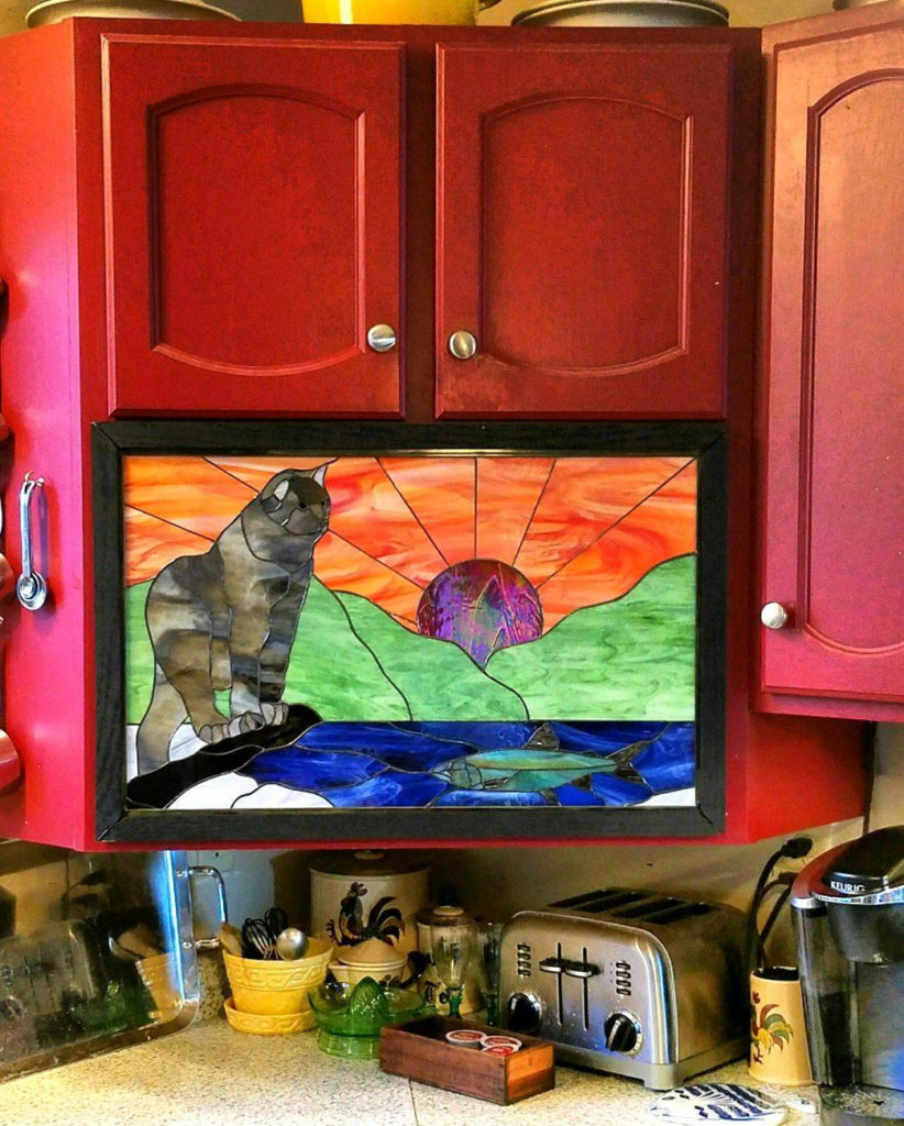 Lynx and trout stained glass cabinet insert