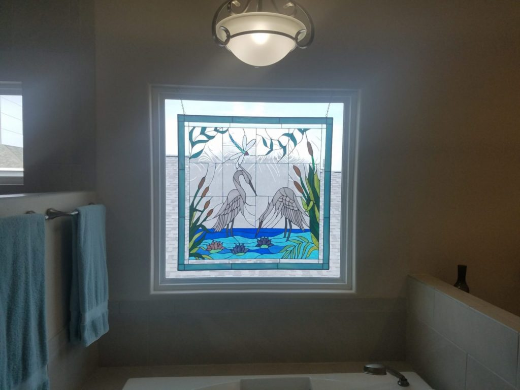 Egret And Water Lilies Stained Glass Panel Hung Above A Bathtub For Decor & Beauty