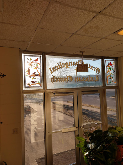 Two stained glass bird & flowers panels made for each side of a transom in a Church entryway