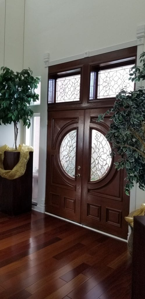 Victorian style brass came beveled windows made for a clients entryway
