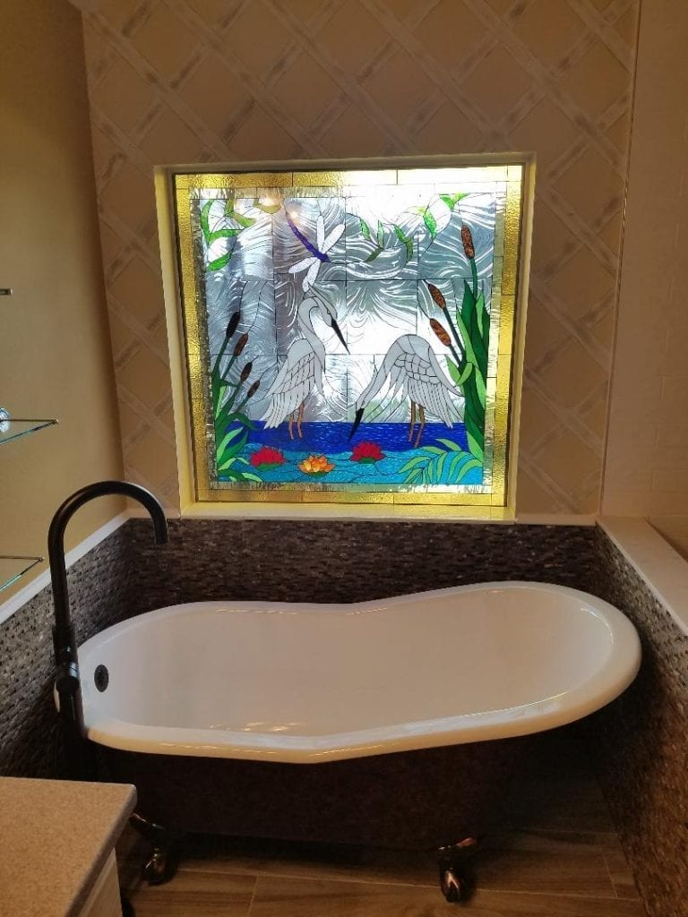 Exquisite Egret/Heron & Water Lily Stained Glass Window Installed Over A Claw Tub In A Bathroom
