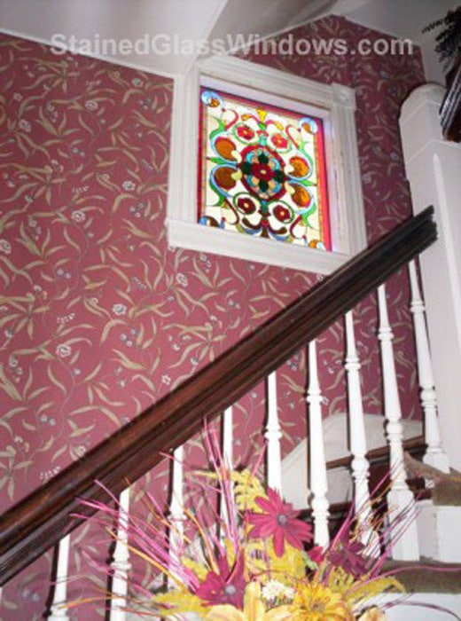 Victorian style stained glass window in stairway