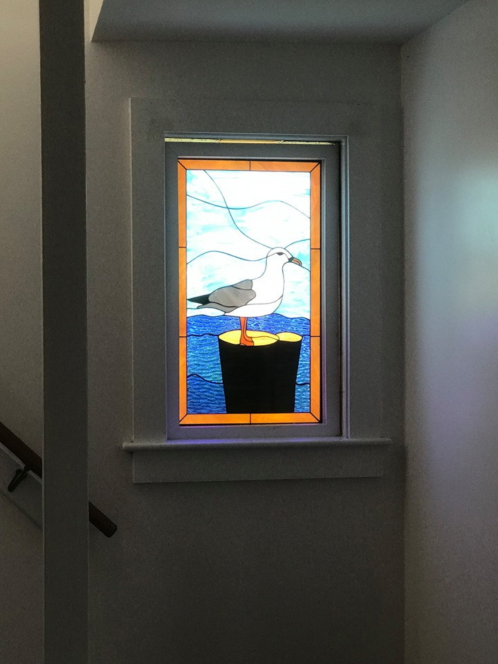 Seagull & Ocean Stained Glass Windows Installed On A Stairwell Landing