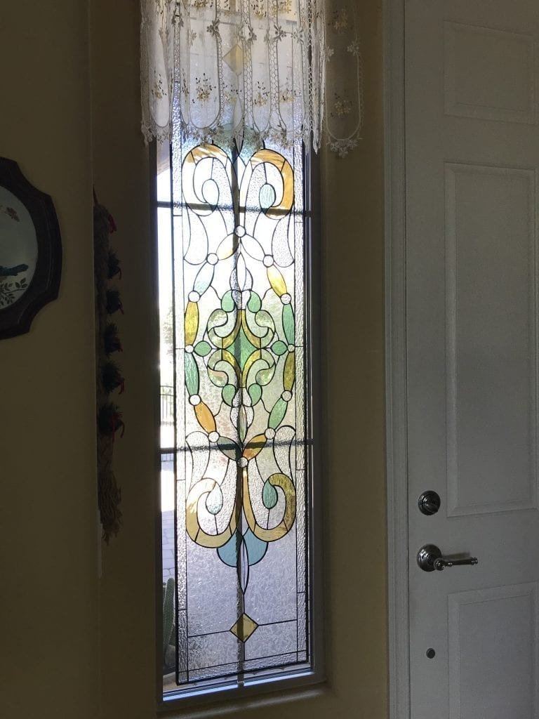 Victorian Stained Glass Window Set Against Existing Window With Grid System And Still Looks Great!