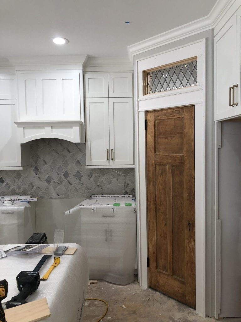 Classic Beveled Diamonds Used As A Transom Window In A Laundry Room