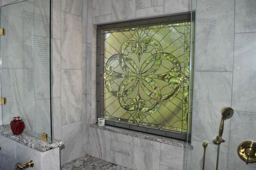 Heavily Beveled Stained Glass Window Installed Over A Bathtub