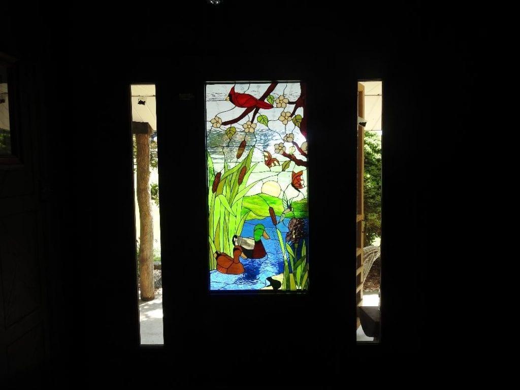Bird & Duck Fantasy Window Installed In A Entry Way Door